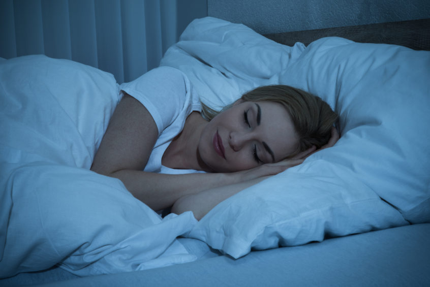 woman sleep well in bed