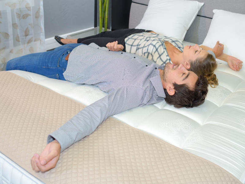 a couple sleeping and trying the restwell mattress at south surrey mattress store